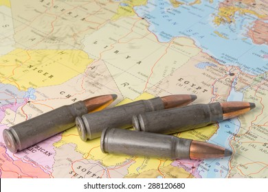 Four bullets on the geographical map of Egypt, Lybia, Algeria and Niger in North Africa. Conceptual image for war, conflict, violence.