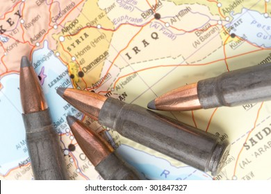 Four bullets on the geographical map of Iraq and Syria in Middle East. Conceptual image for war, conflict, violence.