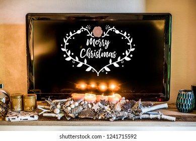 four burning advent candles, beautiful decorated setup light TV in Background textspace saying merry christmas
