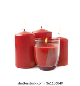Four burning red candles isolated