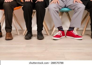 Four business men waiting for an interview
