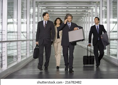 Four business people at the airport.