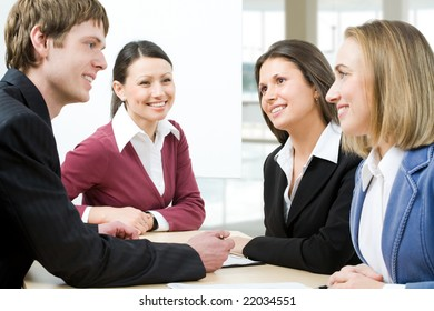 Four business people hold discussion