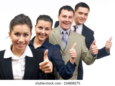 A four business people with smiles showing success