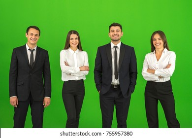 The four business people stand on the green background