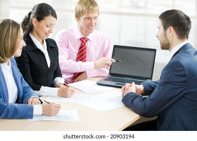 Four business people working in team