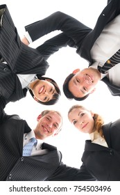 Four business persons forming a circle.