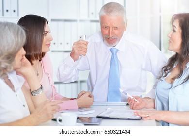 Four businessmen working together