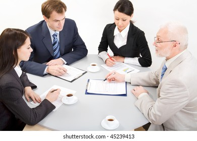 Four businesspeople discussing