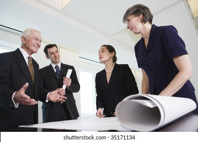 Four businesspeople meeting.
