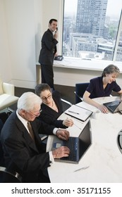 Four businesspeople meeting