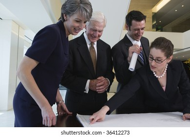 Four businesspeople smiling