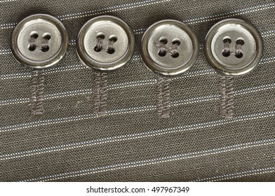 Four buttons on the fabric.