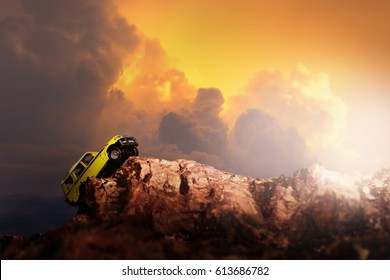 Four by four off road car crossing through the country road. Travel and racing concept for four wheel drive off road vehicle .