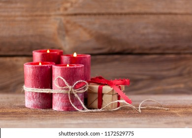 four candles decorated with christmas balls burning , concepts for fourth advent