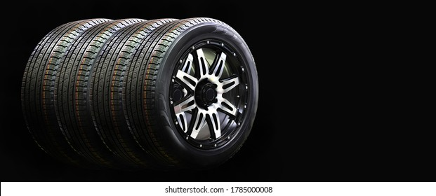 Four car wheel Rubber with Alloy Rim Isolated on Black Background,copy space