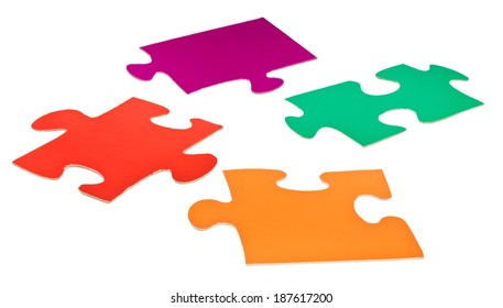 four cardboard flat jigsaw puzzle pieces isolated on white background