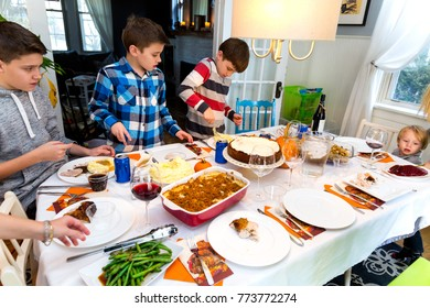 Four Caucasian Brothers Gather Around The Thanksgiving Table Admiring The Food