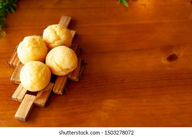 Four cheese buns, cheesecake on wooden table.