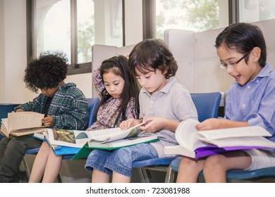 Four children reading on a chair in the classroom, Young students study in the library. Home school back to school concept.