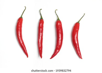 Four Chillies on White Background