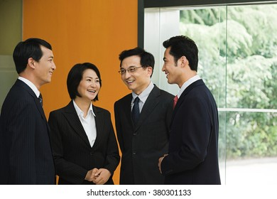 Four Chinese business colleagues