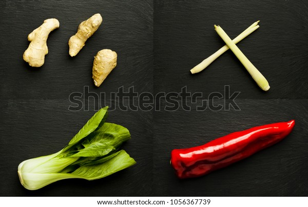 Four Chinese ingredient on black slate surface