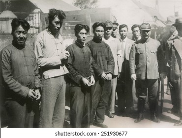 Four Chinese who guarded the British in concession of Tientsin as Japanese prisoners. Accused of murder of a high functionary, they are at the High Court of Chinese Justice. Nov. 4, 1939.