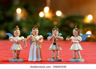 Four Christmas Angels Making Music