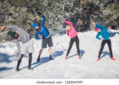 Four colleagues are on company winter team building. They are planning to run this sunny day and discover around the mountain. First, they need to warm up whole body and escape injuries.