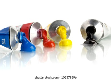 four color, tin tubes squeezed