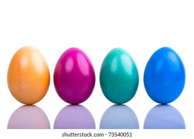 four colored Easter eggs are on a white background with text space