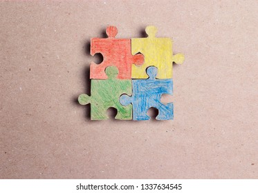 Four colored puzzle pieces. Autism Awareness Day. Autism Spectrum Disorder (ASD) concept.