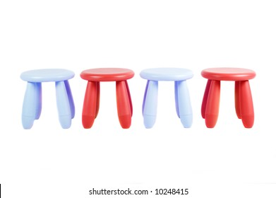 Four colored stools isolated on white