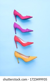 Four colorful high hell shoes isolated over blue, with clipping path.