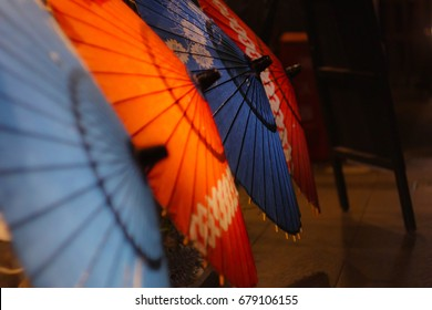 Four colorful japanese umbrellas at night in Kyoto