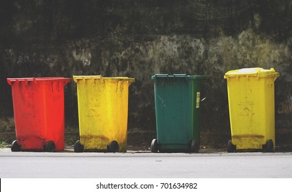 four colorful recycle bin isolated on background