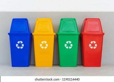 four colorful recycle bins on the floor