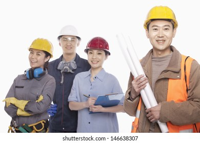 Four construction workers against white background, focus in foreground