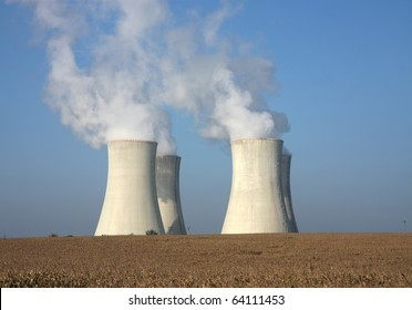 four cooling tower of nuclear power plant and agriculture field
