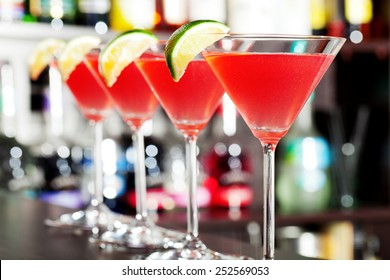 Four cosmopolitan cocktails on a bar
