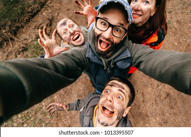 Four crazy funny people selfie. Bizarre scary company mess outdoor. Disgusting creepy fellows fooling around. Unusual dirty face emotions. Wide angle distortions. Evil family. Expressive men, women
