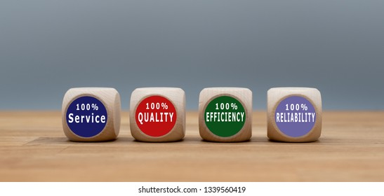 "Four cubes with the text ""100% Service"", ""100% Quality"", ""100% Efficiency"" ,""100% Reliability"" ."