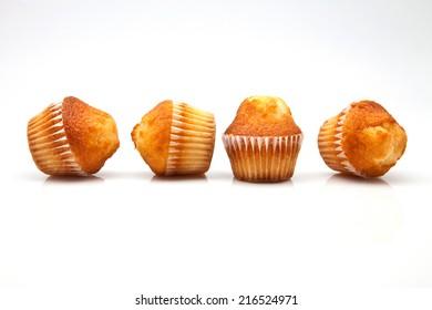 four cupcakes on white background