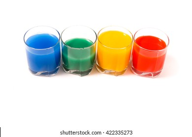 four cups of juice on a white background