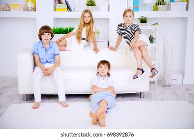 Four cute children spend time together at home. Child concept. Kid's fashion.