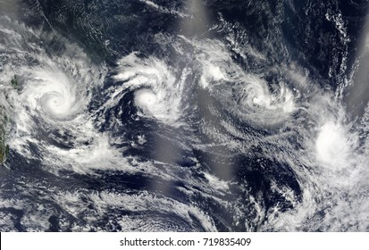 Four cyclones. View from space. Elements of this image are furnished by NASA