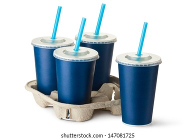 Four dark blue takeout cups with a cup holder. Isolated on a white.