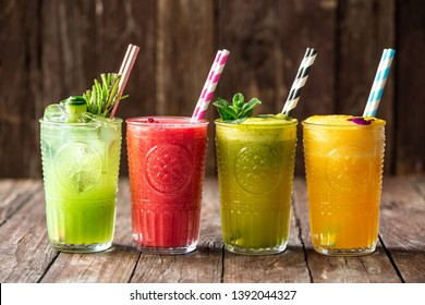 Four delicious smoothies in four glasses, natural energy source