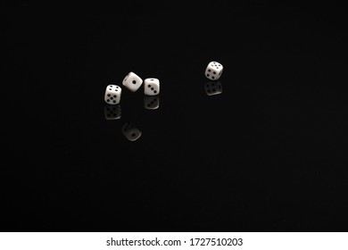 Four dices ruling on the black table